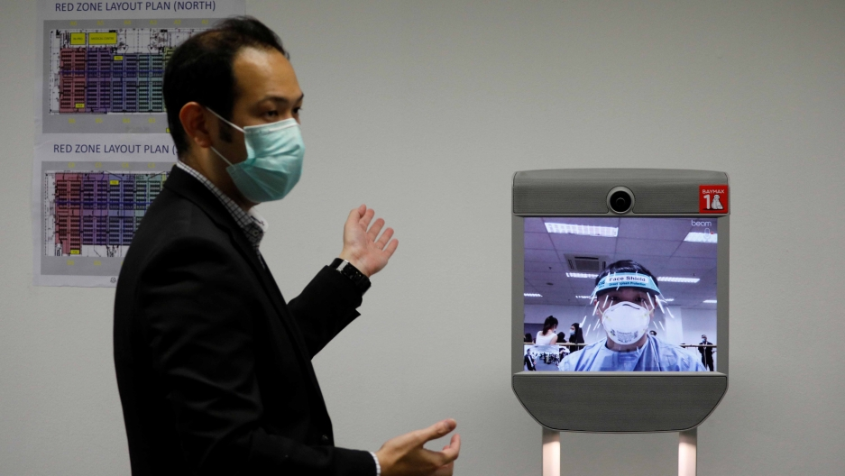 "A ""telepresence"" robot which provides face-to-face medical consultation is pictured at Changi Exhibition Centre which has been repurposed into a community isolation facility that will house recovering or early COVID-19 patients with mild symptoms."