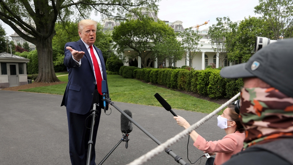 US President Donald Trump speaks to reporters as he departs the White House for travel to Michigan during the coronavirus disease (COVID-19) outbreak in Washington, DC, on May 21, 2020.