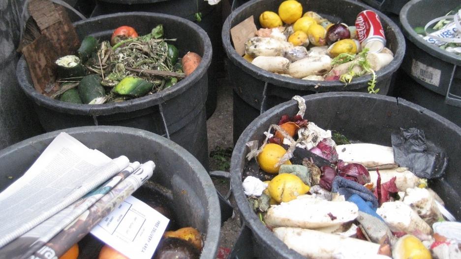 Trash bins full of food