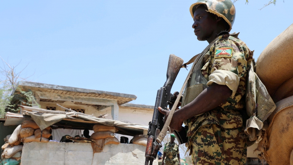 A Burundian African Union Mission in Somalia (AMISOM) peacekeeper stands guard before being replaced by the Somali military at Jaale Siad Military academy in Mogadishu, Somalia.