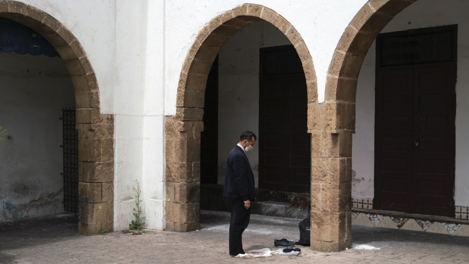 A man prays in the deserted Habbous neighborhood of Casablanca.