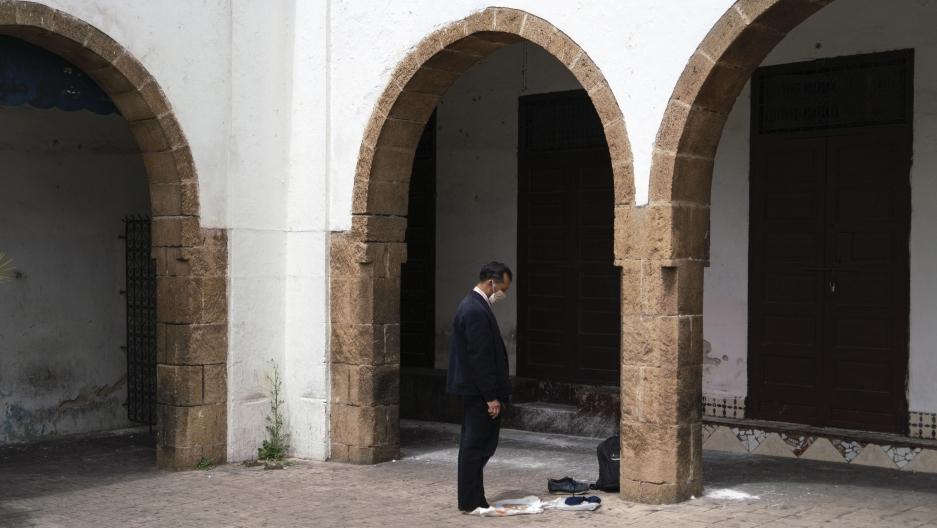 A man prays in the deserted Habbous neighborhood of Casablanca.