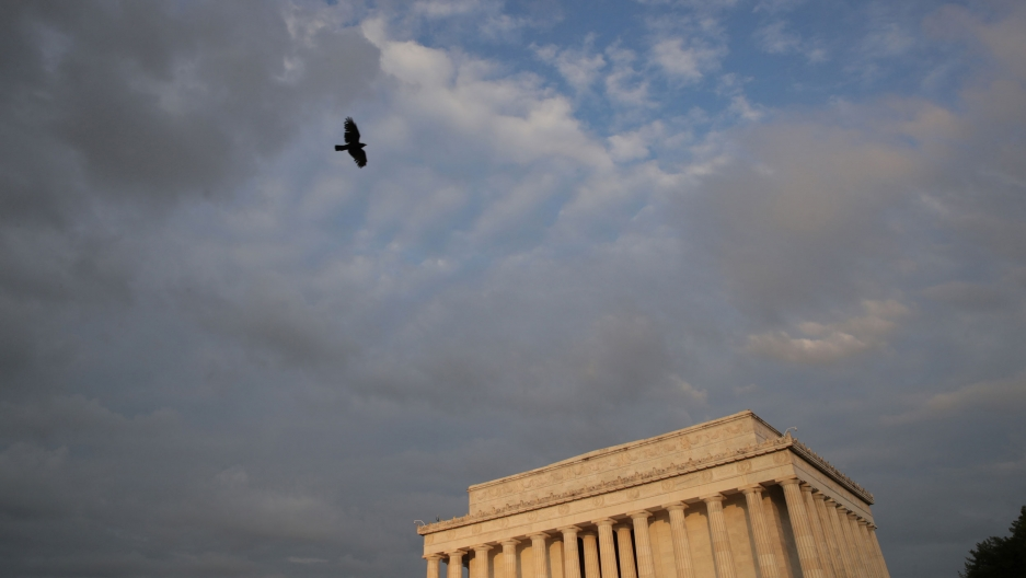The Lincoln Memorial is shown with a colorful sunrise in the distance.
