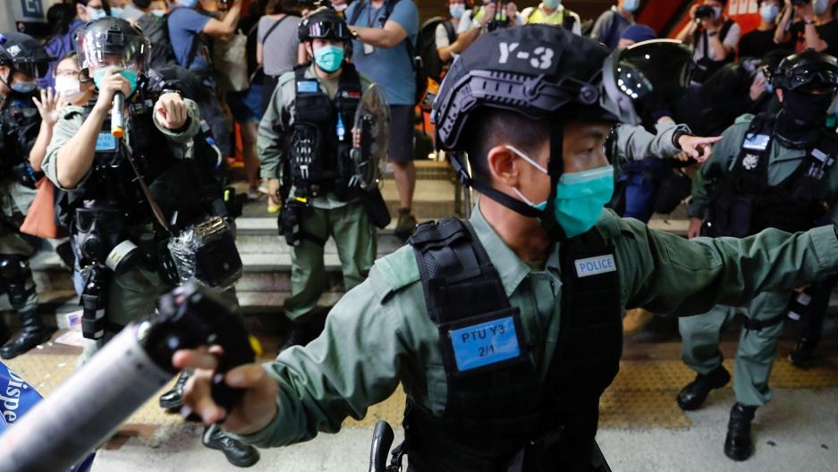 Riot police disperse pro-democracy demonstrators