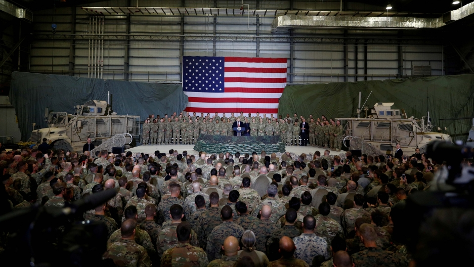 US President Donald Trump delivers remarks to US troops during an unannounced visit to Bagram Air Base, Afghanistan on November 28, 2019.