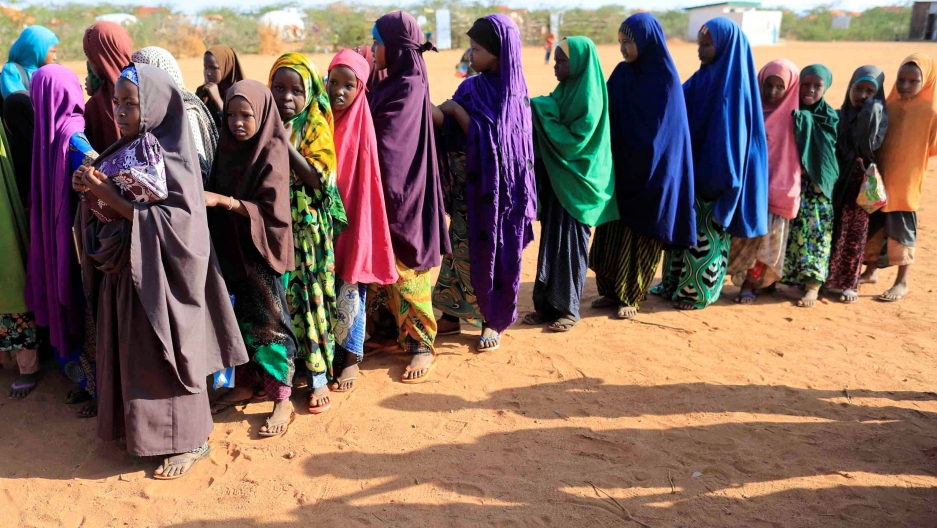 Internally displaced girls in Somalia queue before at a school beside an IDP camp in Dollow, Somalia, April 4, 2017.