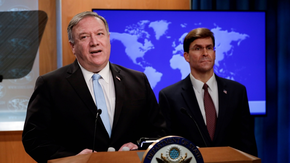 US Secretary of State Mike Pompeo speaks about a Trump administration executive order on the International Criminal Court as Defense Secretary Mark Esper listens during a joint news conference at the State Department in Washington, June 11, 2020.