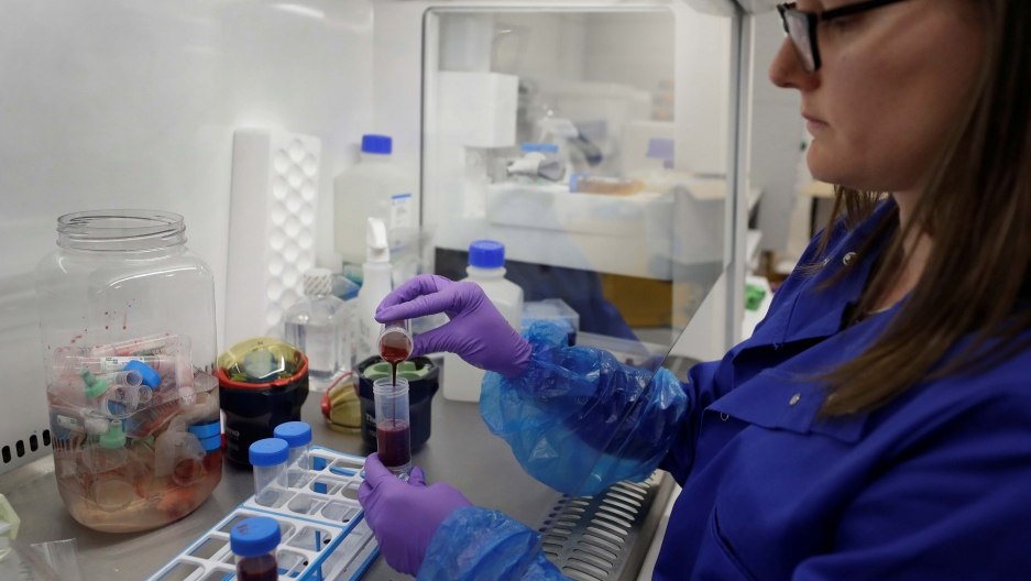 A PhD research associate prepares blood samples from patients infected with the coronavirus disease (COVID-19) for analysis at the Cambridge Institute of Therapeutic Immunology and Infectious Disease, in Cambridge, Britain, on May 21, 2020.