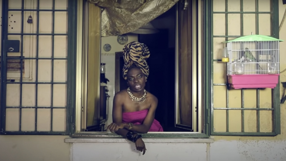 "A screenshot from Liberian Italian artist Karima 2G's 2014 music video, ""Bunga Bunga,"" in which she raps about racism and objectification of women."