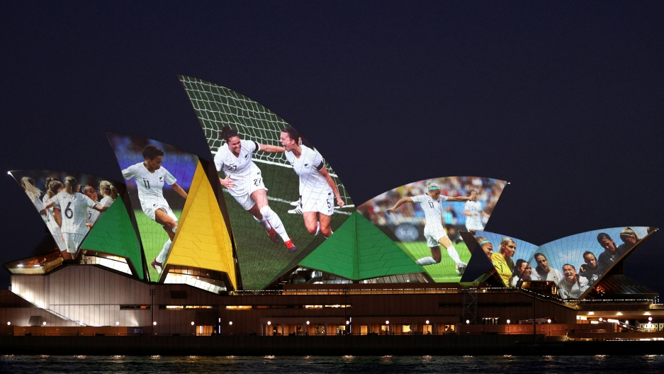 The Sydney Opera House is shown at night lit up with photographs from the FIFA Women's World Cup.