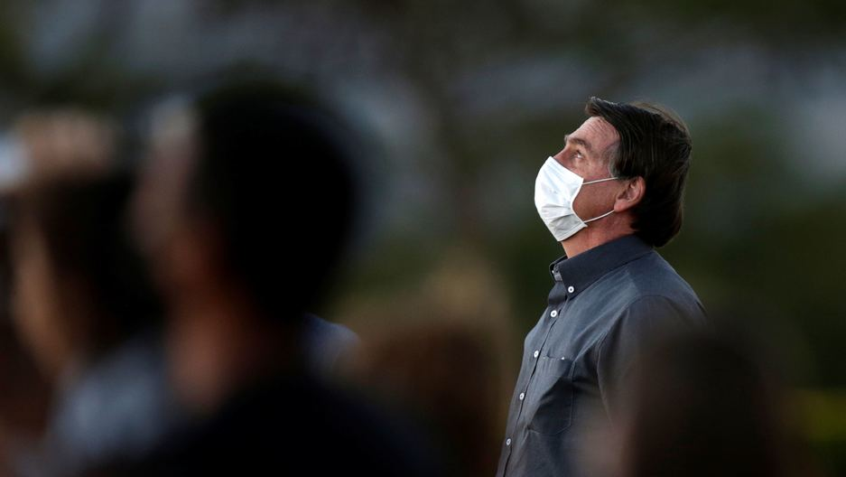Brazil's President Jair Bolsonaro is seen during a ceremony to lower the Brazilian National flag down for the night, at the Alvorada Palace, amid the coronavirus outbreakin Brasília, Brazil, July 20, 2020.