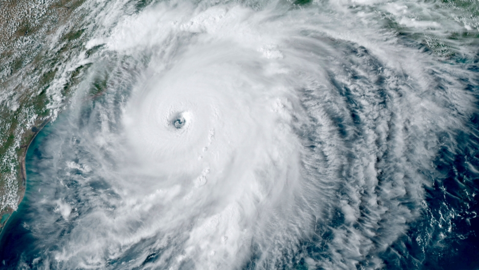A satellite image provided by NOAA shows Hurricane Laura over the Gulf of Mexico.