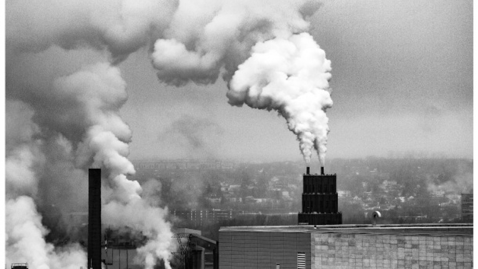 gray and white smokestacks billow