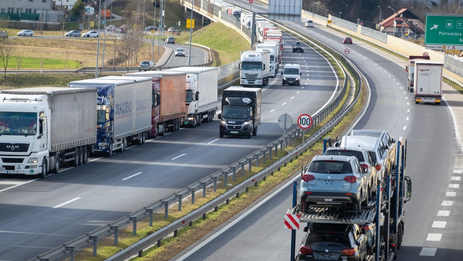 A line of trucks snake down the motorway