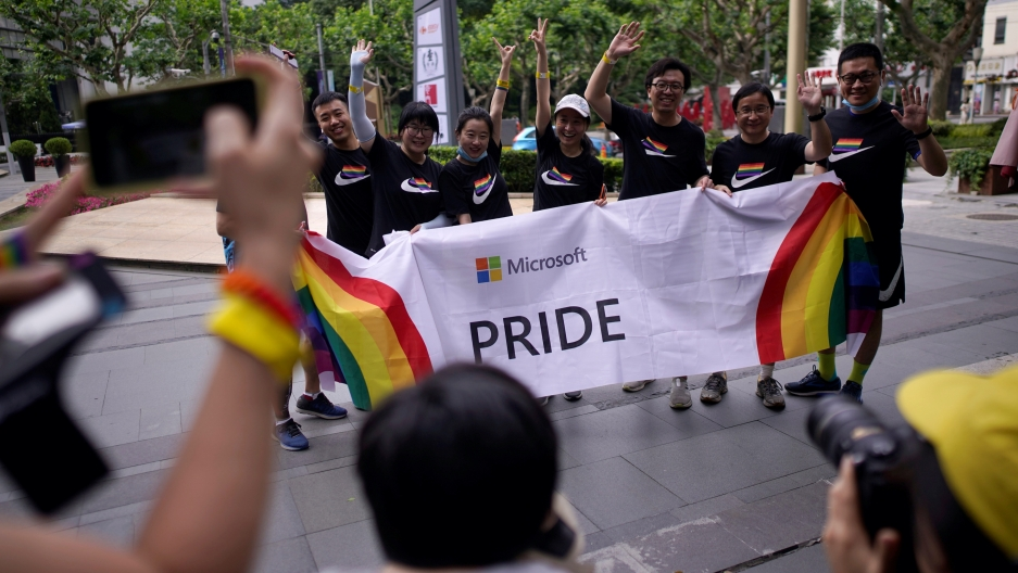 Participants take part in a Pride run during the ShanghaiPRIDE festival