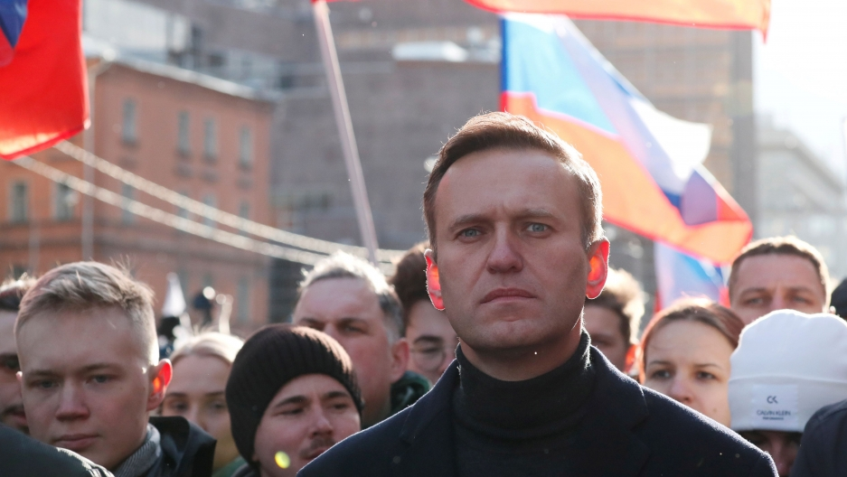 Russian opposition politician Alexei Navalny takes part in a rally to mark the 5th anniversary of opposition politician Boris Nemtsov's murder and to protest against proposed amendments to the country's constitution, in Moscow, Feb. 29, 2020.
