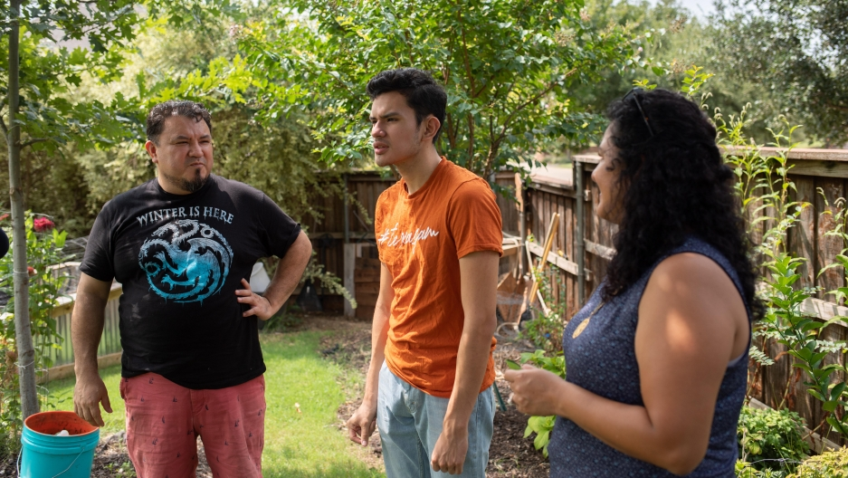 Izcan Ordaz, center, has been spending more time with his parents Simon Ordaz, left, and Xochitl Ortiz during the pandemic.