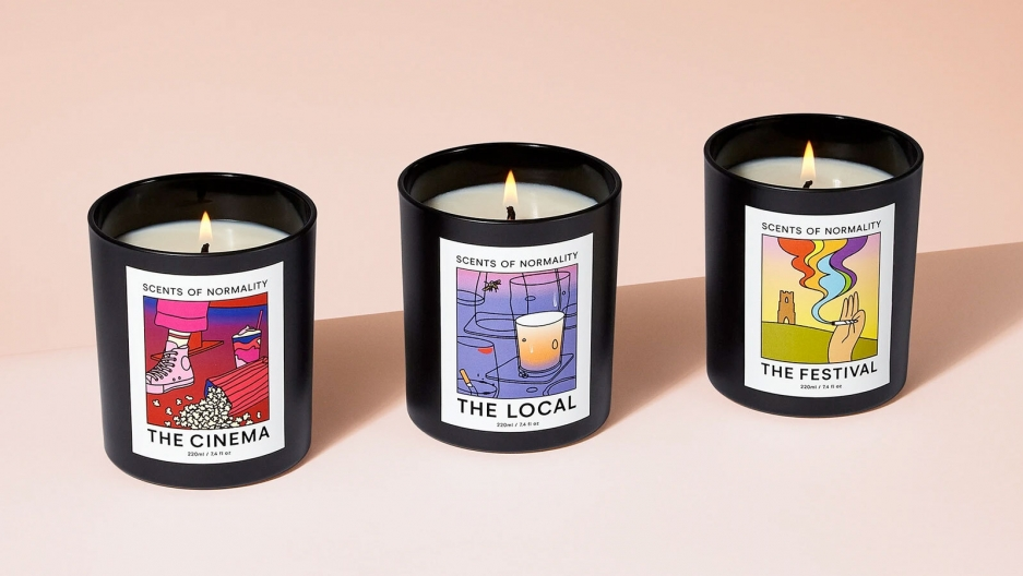Three candle jars with colorful labels