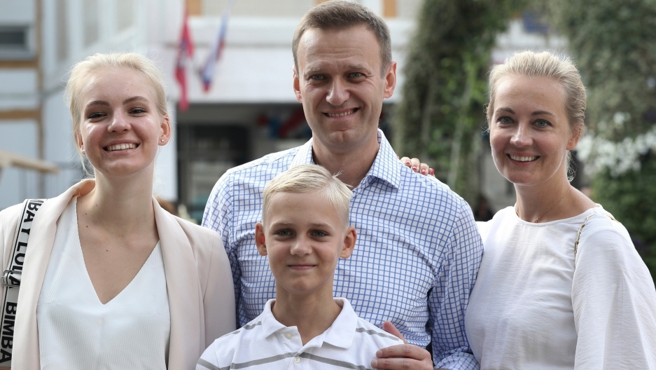Russian opposition leader Alexei Navalny, with his wife Yulia, right, daughter Daria, and son Zakhar pose for the media after voting during a city council election in Moscow, Russia.