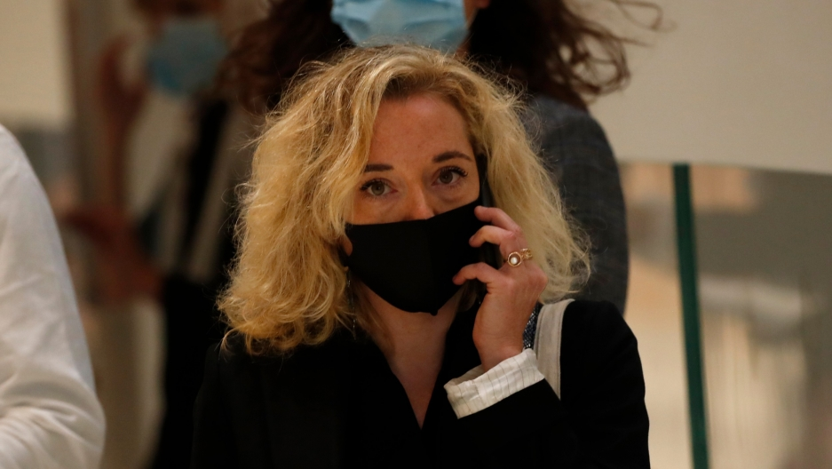 Chloe Verlhac, widow of Charlie Hebdo cartoonist Tignous, arrives at the courtroom for the opening of the 2015 attacks trial, Sept. 2, 2020, in Paris.