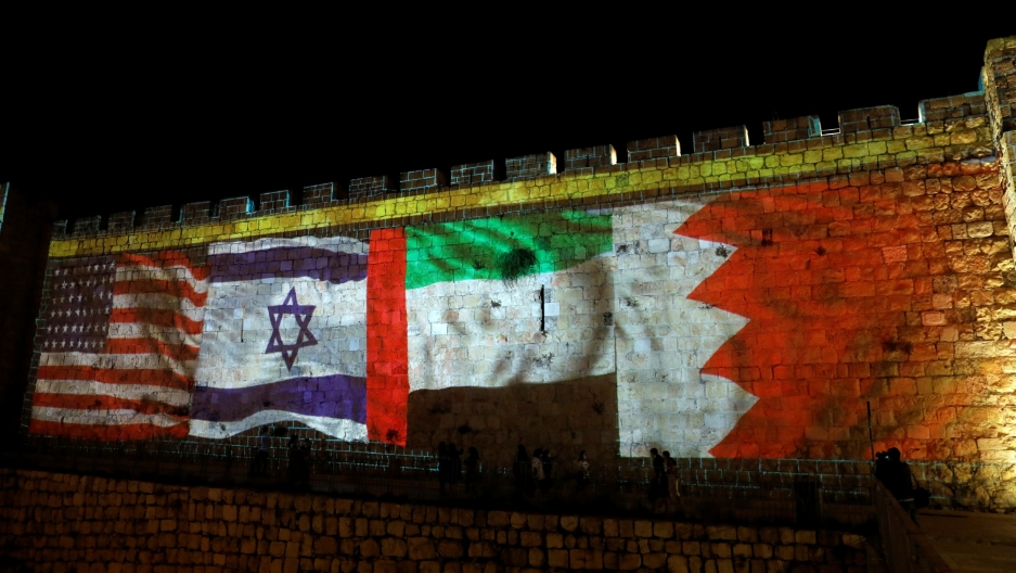 National flags of Bahrain, UAE, Israel and the US are projected onto the walls of Jerusalem's Old city, Sept. 15, 2020.