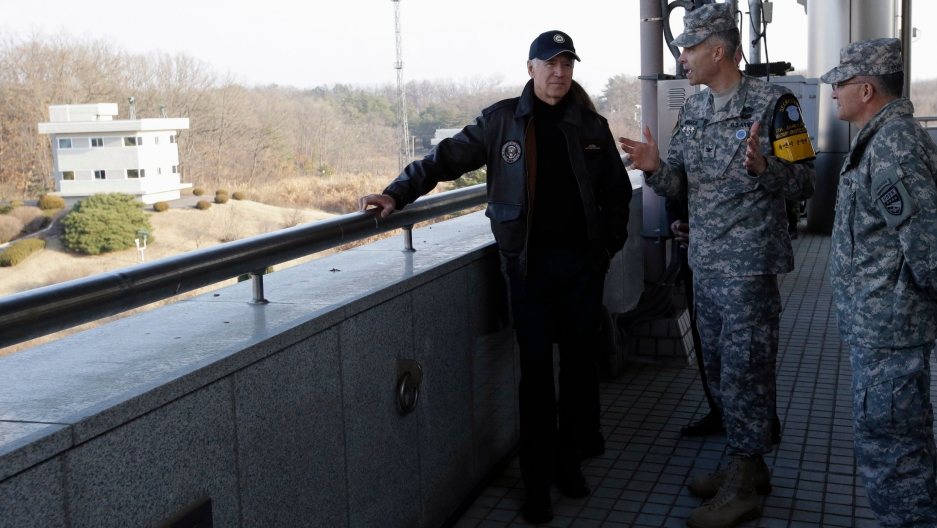 In this file photo from Dec. 7, 2013, US Vice President Joe Biden listens to Colonel James Minnich, Secretary of the United Nations Command, Military Armistice Commission, at the border village of Panmunjom, in the Demilitarized Zone (DMZ), the military b