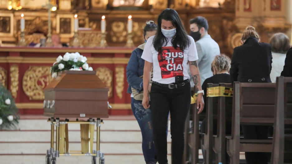 """A family member of Javier Ordonez, who died after being detained by thepolice, wears a T-shirt that reads: """"Justice for Javier"""" during his funeral in Bogota,Colombia, Sept.16, 2020."""