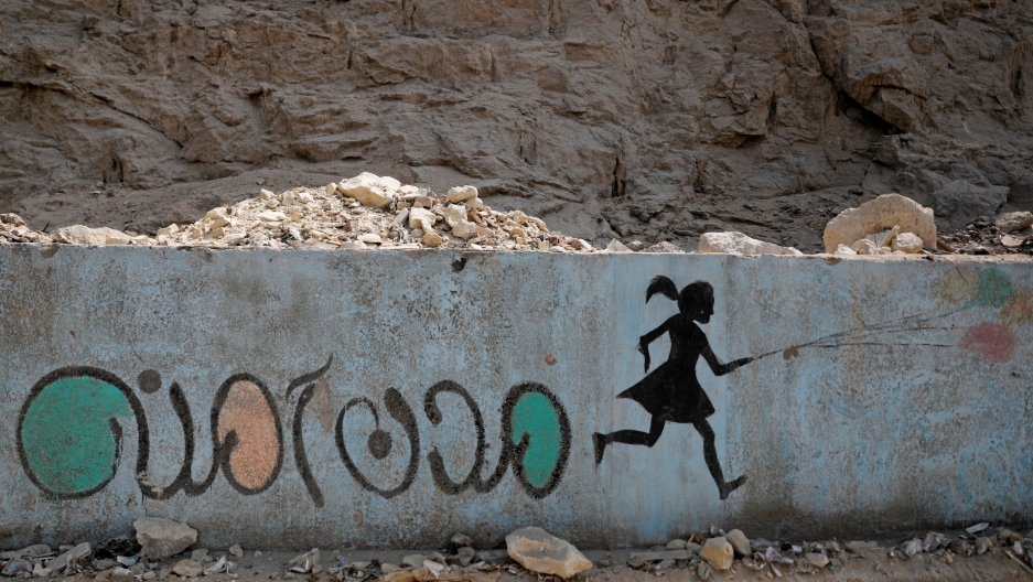 """In this file photo, a mural depicting messages against sexual harassment and reading """"safe cities"""" in Arabic script is seen ona highway in Cairo,Egypt, Sept.3, 2018."""