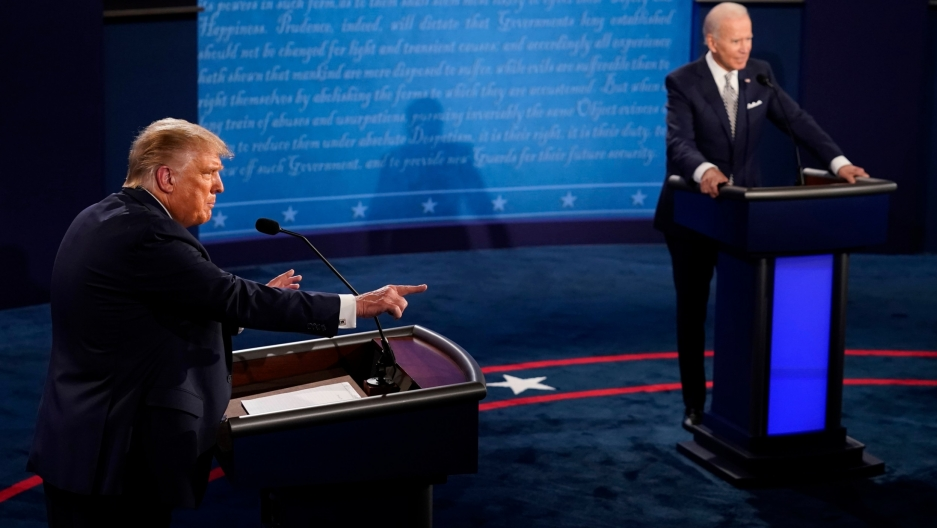 President Donald Trump points as Democratic presidential candidate former Vice President Joe Biden listens during the first presidential debate,Sept. 29, 2020, at Case Western University and Cleveland Clinic, in Cleveland, Ohio.