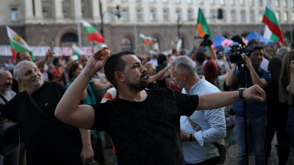 A protester throws an egg at theBulgarian government building during an anti-government demonstration.