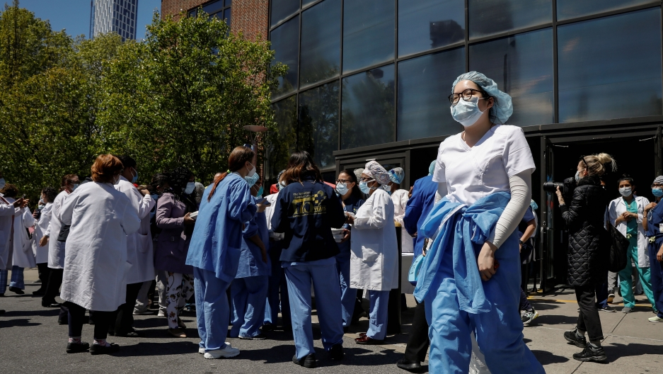 Health care workers gather for lunch purchased by members of the New York City Police Department (NYPD)