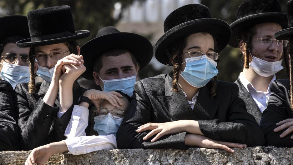 Ultra-Orthodox Jewish teens attend the funeral for Rabbi Mordechai Leifer in Ashdod, Israel,Oct. 5, 2020.