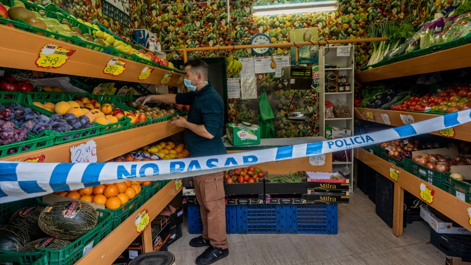 A no-trespassing sign is used to keep social-distance guidelines at a vegetable shop in Madrid, Spain.