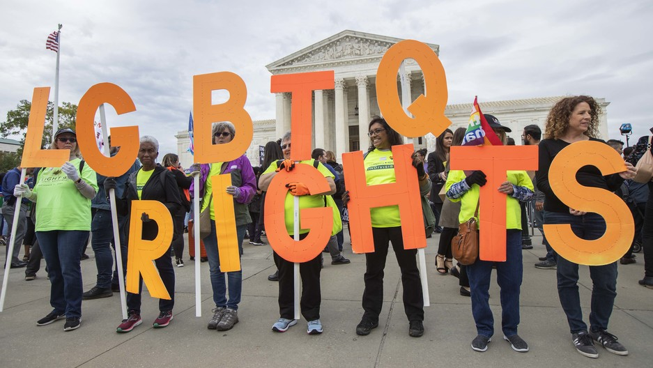 In this Oct. 8, 2019, file photo, supporters of LGBTQ rights hold placards in front of the U.S. Supreme Court in Washington, DC.