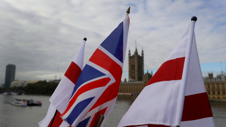 UK and England flags fly above a souvenir stand opposite Britain's Parliament in London, Oct. 16, 2020.