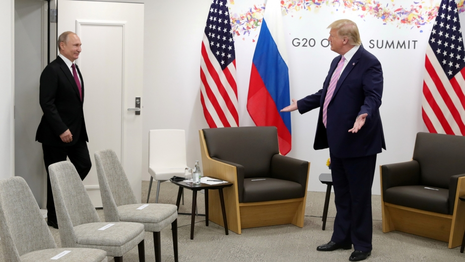 Russia's President Vladimir Putin is greeted by US President Donald Trump at the G20 summit in Osaka, Japan, June 28, 2019.