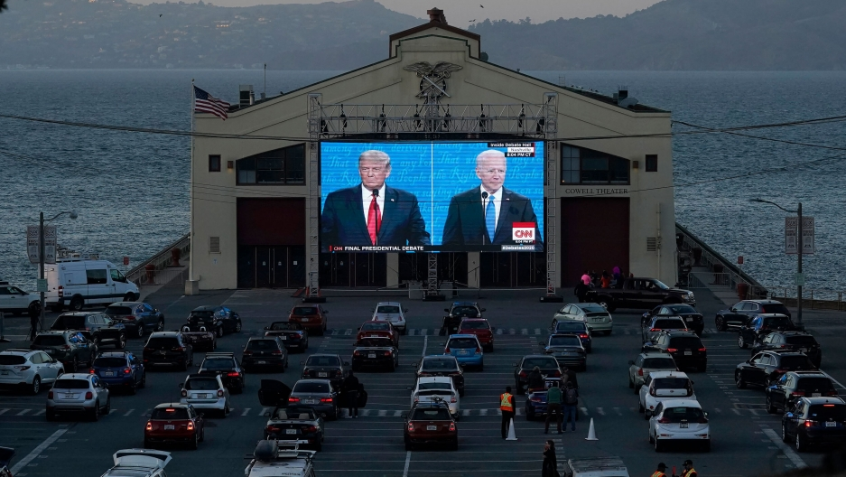 People watch from their vehicles as US President Donald Trump and Democratic presidential candidate former Vice President Joe Biden speak during a Presidential Debate Watch Party at Fort Mason Center in San Francisco, Oct. 22, 2020.