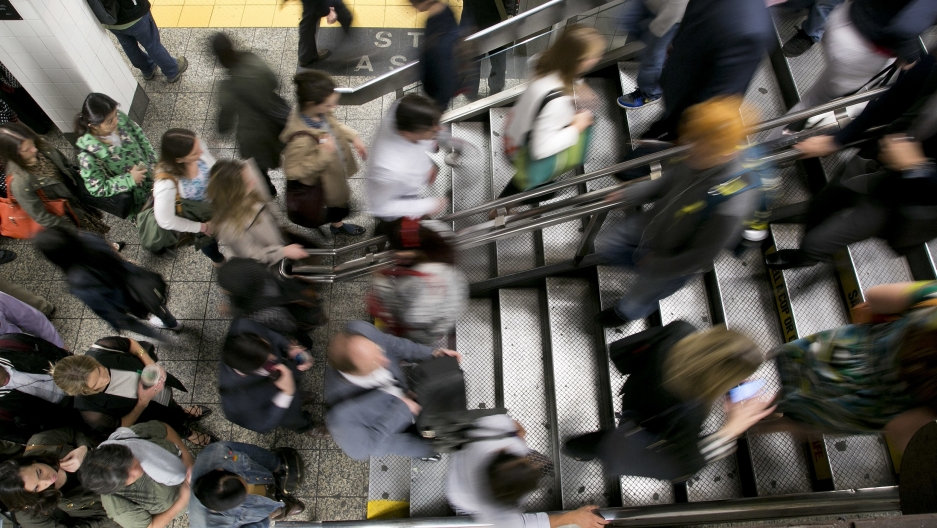 A crowd of people rushing in a subway station