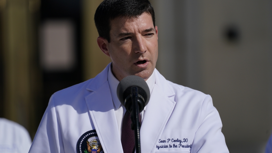 Dr. Sean Conley, physician to US President Donald Trump, is shown wearing a white medical jacket with a US presidential shield page on the breast.