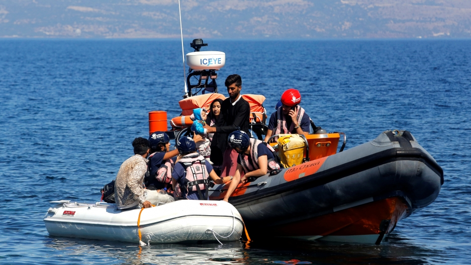 A small inflatable boat carrying migrants from Afghanistan is towed by a rescue vessel of the Refugee Rescue NGO, near Skala Sikamias, on the island of Lesbos, Greece, Sept. 16, 2019.