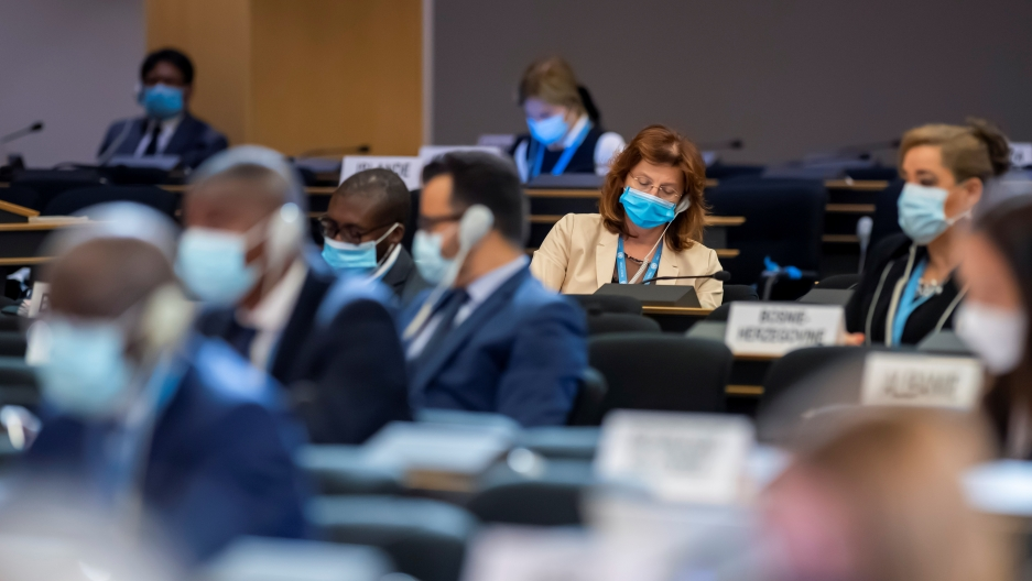 Delegates, wearing masks, listen to speeches during the 45th session of the Human Rights Council, at the European UNheadquarters in Geneva, Sept.14, 2020.