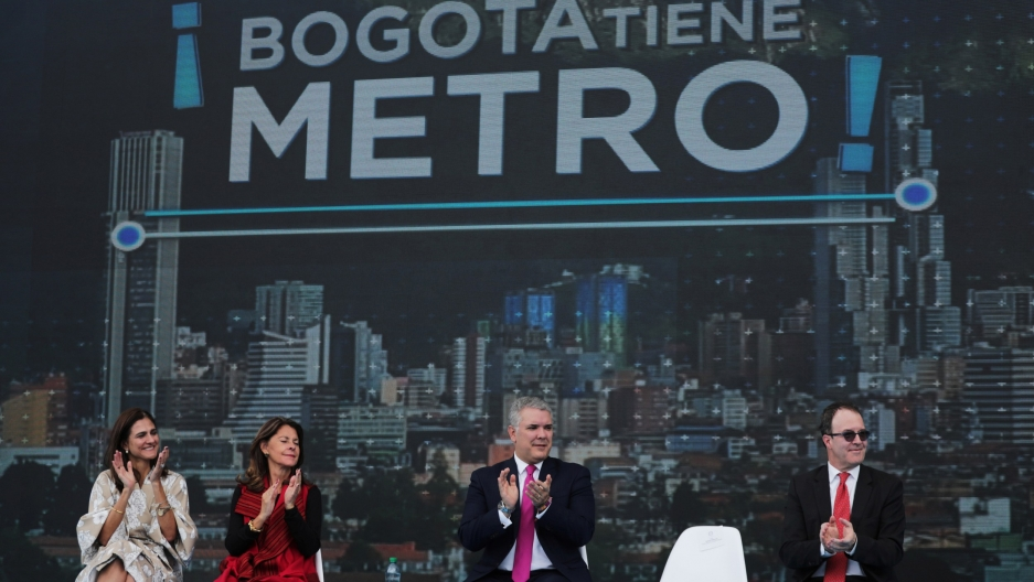 Colombia's President Iván Duque, reacts during the presentation of the award of the contract for the construction of the Bogotá subway, Oct. 17, 2019.