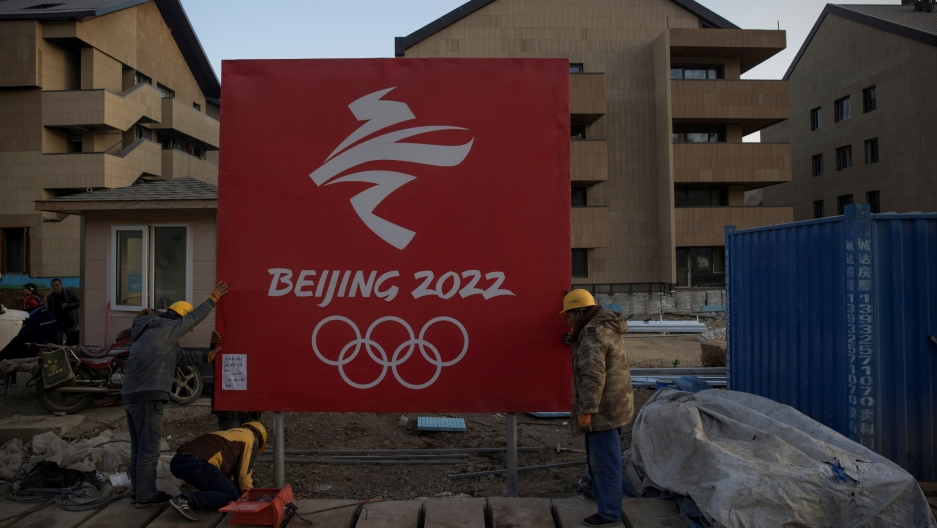 Workers move a sign at the Olympic Village for the 2022 WinterOlympicsin the Chongli district of Zhangjiakou, Hebei province,China, Oct.29, 2020.