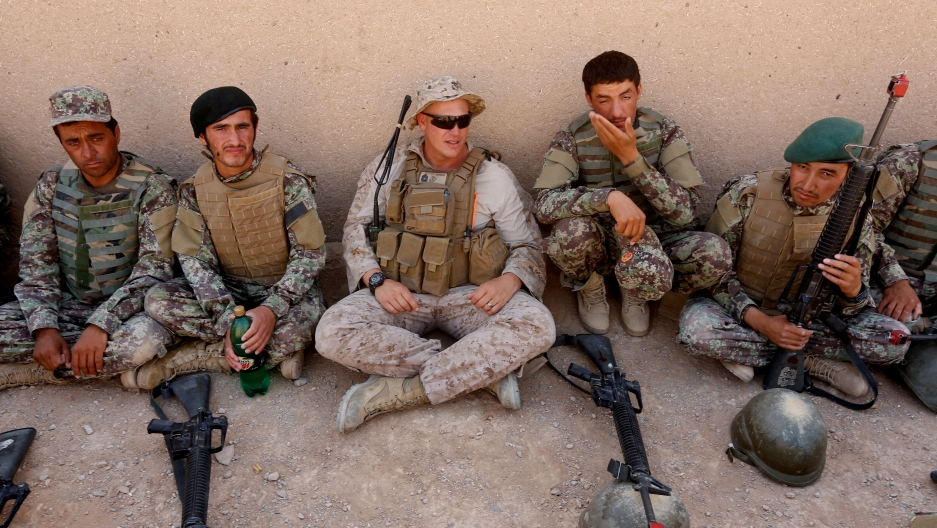 A USMarine (center)talks with Afghan National Army (ANA) soldiers during a training in Helmand province, Afghanistan, July 5, 2017.