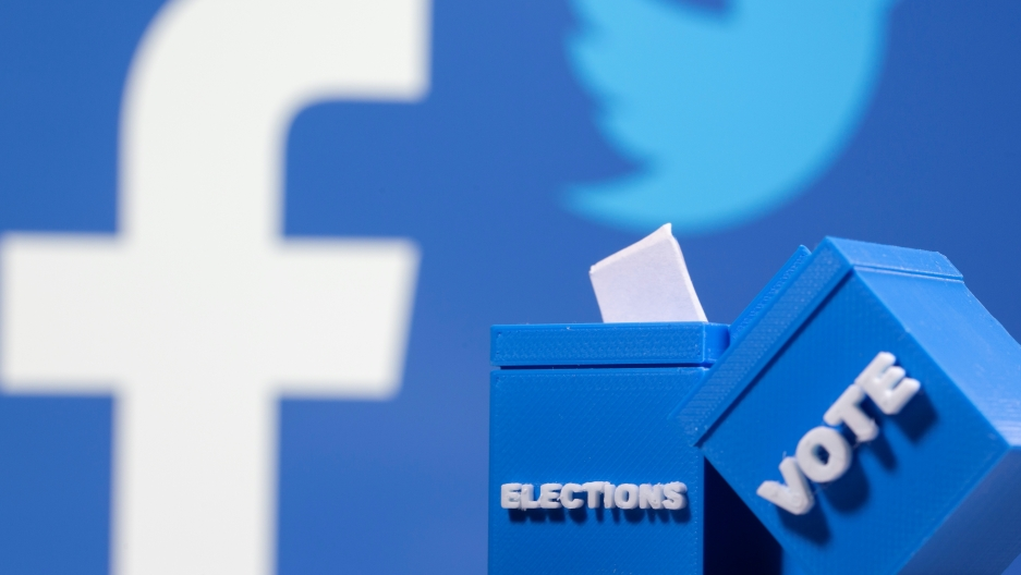 """Blue background with Facebook and Twitter logo and two blue boxes with """"election"""" and """"vote"""" written on it in white letters"""
