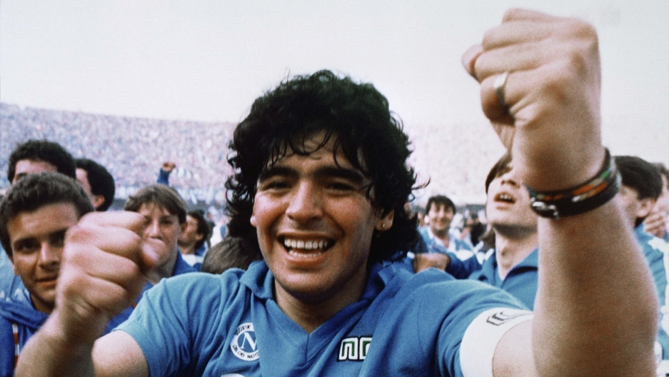 Argentine soccer superstar Diego Armando Maradona cheers after the Napoli team clinched its first Italian major league title in Naples, Italy, on May 10, 1987.