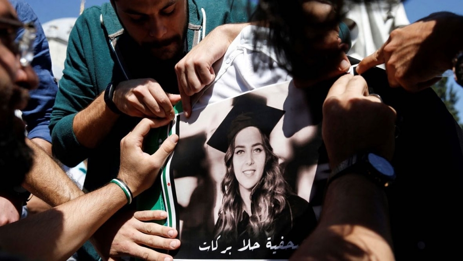 The funeral of Syrian anti-Assad activist Orouba Barakat, 62, and her daughter, American journalist Halla Barakat (pictured), 23. The pair were found stabbed to death in their apartment in Istanbul on Sept. 21, 2017.