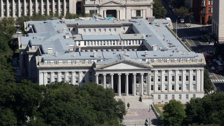 The US Treasury Department building is shown from above with its large Greek columns marking the entrance.