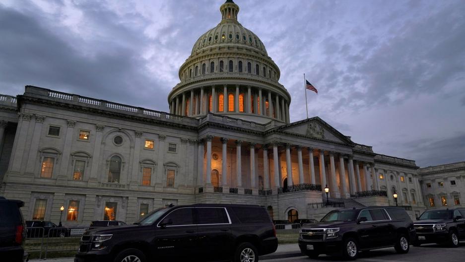 Dusk falls over the Capitol, Dec. 21, 2020, in Washington.