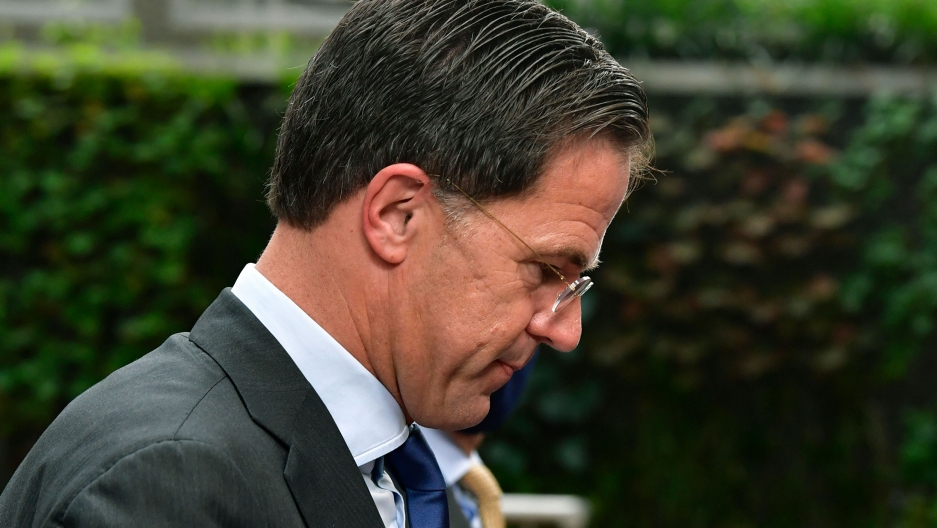 Netherlands' Prime Minister Mark Rutte is shown in a close-up photograph wearing a gray suit and looking down.